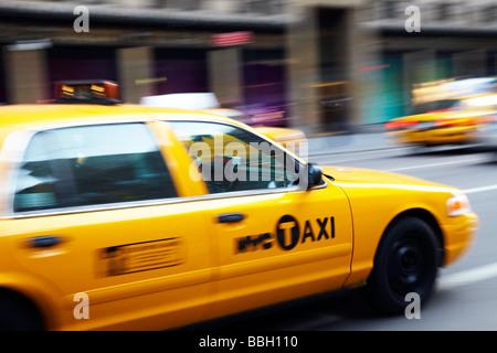 yellow taxi in street, New York - Stock Photo