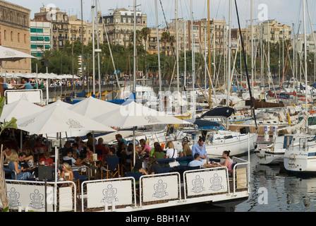 Outdoor restaurant in harbor Barcelona Catalonia Spain - Stock Photo
