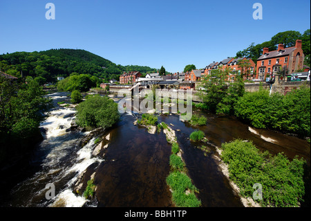 River Dee in Llangollen with steam railway station in the background - Stock Photo