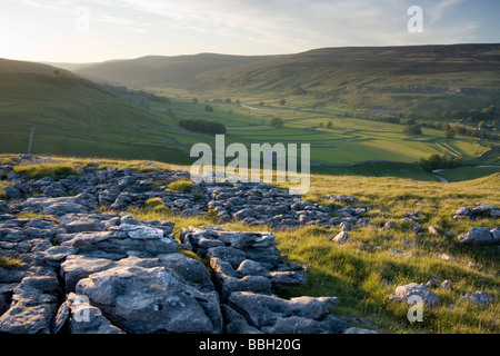Limestone pavement and the view along Littondale, in the Yorkshire Dales, from above the village of Arncliffe. - Stock Photo