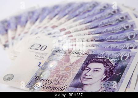 'twenty pounds' note 'twenty pound' notes money sterling currency bundle stack - Stock Photo