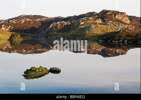 Isle of Harris still ocean loch reflections, Outer Hebrides, Scotland - Stock Photo