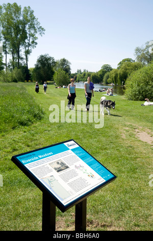 People walking the dog by the river Thames on the towpath, Wallingford, Oxfordshire, UK - Stock Photo