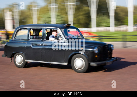 Black cab moving - Stock Photo