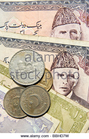 Pakistan currency Rupee notes and coins - Stock Photo