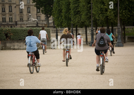 A group of cyclists in Jardin du Carrousel in Paris France - Stock Photo