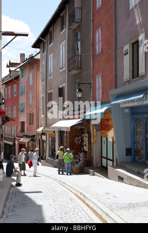 BRIANCON OLD TOWN MAIN STREET WITH COLORFUL HOUSES AND TOURISTS WALKING AROUND, HAUTES ALPES, FRANCE - Stock Photo