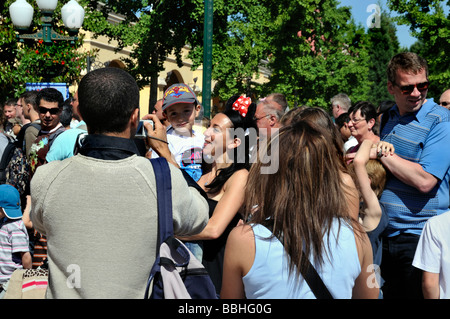 Paris France, Theme Parks, People Visiting Disneyland Paris Entrance, Father Taking Photos of Family - Stock Photo