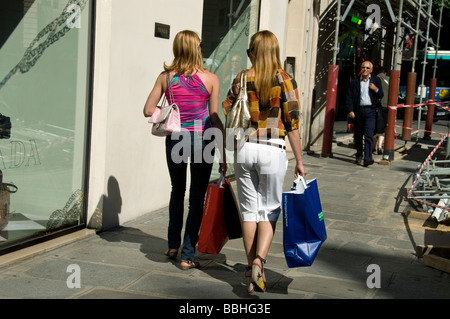 Paris France, Women Walking away, Luxury Clothes Shopping, Busy Street Scene, Outside Prada Store, ('Rue Faubourg - Stock Photo