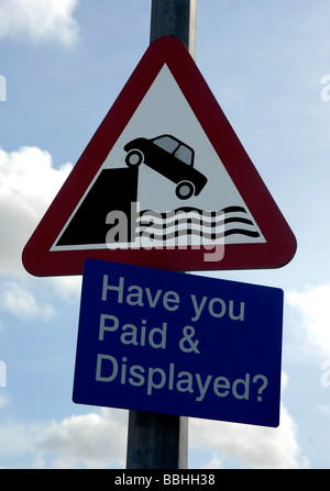 Harbour warning sign with Pay and Display sign, UK - Stock Photo