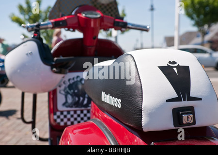 Vespa scooter, customised with logos and images of the pop/ska band, Madness - Stock Photo