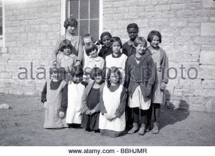 1920s USA mixed ethnicity rural elementary school girls class - Stock Photo