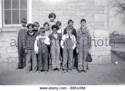 female teacher posing with an all boys class USA 1920s - Stock Photo
