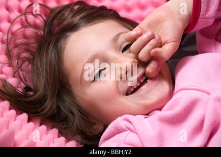 A beaming mischievious little French girl. Petite fille Française amusée et hilare. - Stock Photo