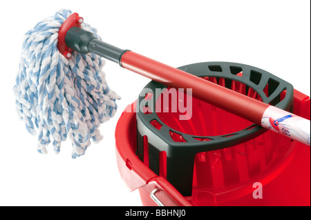 Red mop handle and plastic bucket - Stock Photo