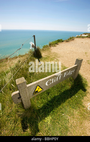 Warning signs on the clifftop at Beachy Head a notorious suicide spot in the UK - Stock Photo