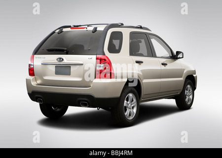 2009 Kia Sportage 4X in Gold - Rear angle view - Stock Photo