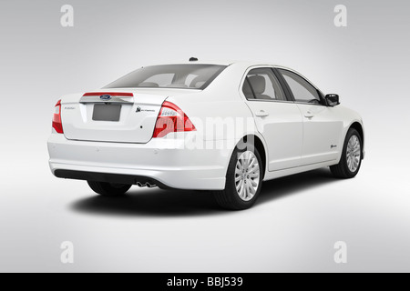 2010 Ford Fusion Hybrid in White - Rear angle view - Stock Photo