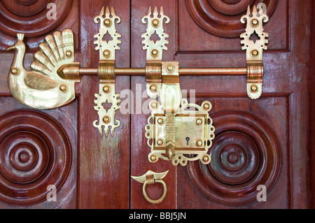 ornate decorated wooden door with brass knocker in the old city