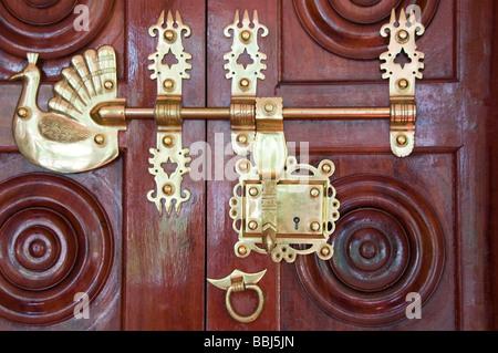antique traditional brass door latch and lock on wooden doors