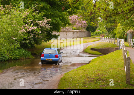 a car driving through a ford running across a country lane in the uk stock photo 24372894 alamy. Black Bedroom Furniture Sets. Home Design Ideas