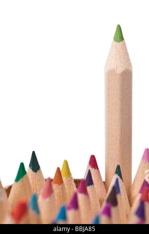Studio shot of a green pencil rising out from the other colored pencils in a pot Environmental concept shot with - Stock Photo