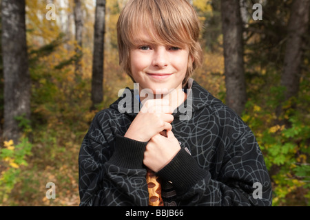 10 year old boy with walking stick on trail in woods, Lake Katherine, Riding Mountain National Park, Manitoba - Stock Photo