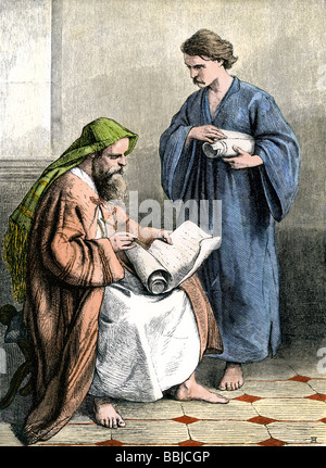 Paul in a Roman prison writing the Epistles. Hand-colored woodcut - Stock Photo