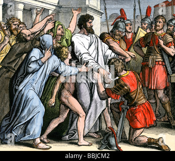 Arrest of the apostle Paul in Jerusalem to be sent to prison in Caesarea. Hand-colored woodcut - Stock Photo