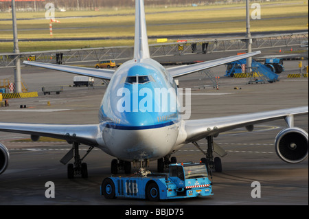 Boeing 747 400 Orlando being tugged on Schiphol Airport Amsterdam Holland - Stock Photo