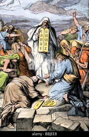 Moses giving the tablets with the Ten Commandments to the people of Israel. Hand-colored woodcut - Stock Photo