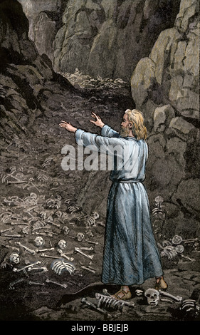 Hebrew prophet Ezekiel walking through the valley of dry bones. Hand-colored woodcut - Stock Photo