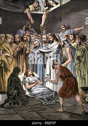 Jesus raising Lazarus from his tomb. Hand-colored woodcut - Stock Photo