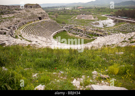 Looking down into the interior of the ancient amphitheater of Miletus from the upper tier in Turkey - Stock Photo