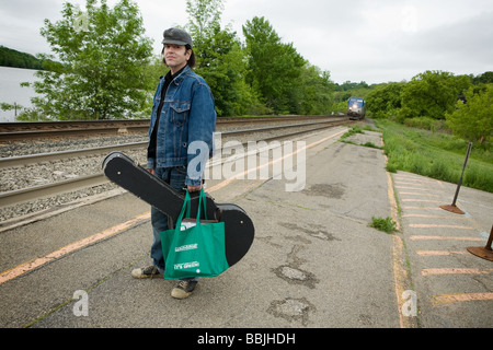 Musician Grant Hart formerly of seminal indy rock band Husker Du catching a train Amsterdam New York - Stock Photo