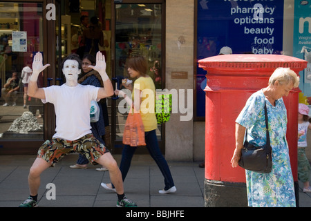 A mime artist being ignored on Sidney Street, Cambridge, UK - Stock Photo