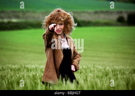 A girl in a field of barley - Stock Photo