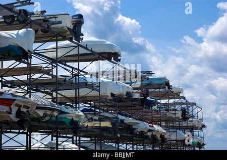 Low angle view of the hull of boats on a boat storage rack - Stock Photo