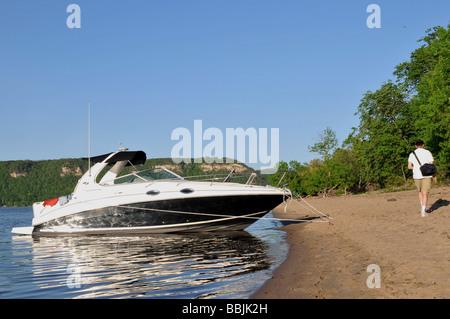 Anchored boat on sandy beach. - Stock Photo
