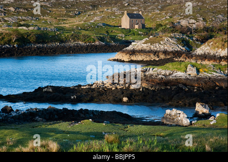 Isle of Harris house next to an ocean loch, Outer Hebrides, Scotland - Stock Photo