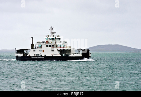 Caledonian MacBrayne car ferry Loch Portain approaching Berneray from Leverburgh on Harris in the Outer Hebrides - Stock Photo