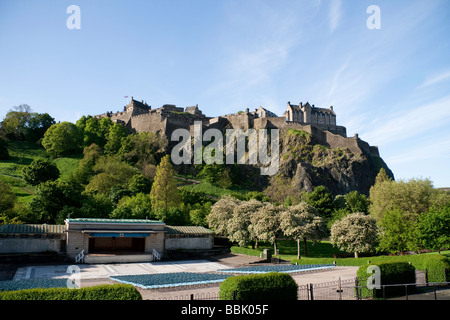 Edinburgh Castle and the Ross Bandstand in Princes Street Gardens on a summer's day - Stock Photo