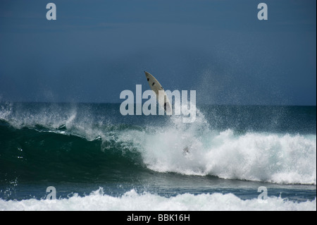 Surfing Arugam Bay Wipe out - Stock Photo