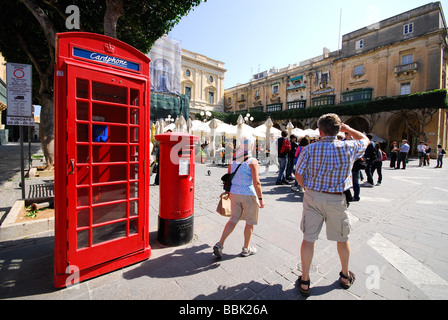 MALTA. Traditional red British phonebox and postbox on Republic Square in Valletta. 2009. - Stock Photo