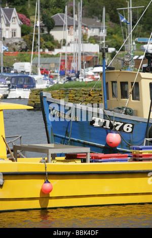 Village of Tarbert, Loch Fyne Scotland. Fishing boats berthed in Tarbert Harbour. - Stock Photo