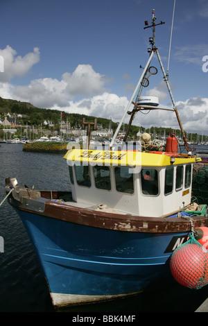 Village of Tarbert, Scotland. Fishing boats berthed in Tarbert harbour. - Stock Photo