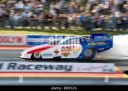 Top Methanol Funny Car dragster driven by Jurgen Nagel at the FIA European Drag Racing Championship at Santa Pod, - Stock Photo