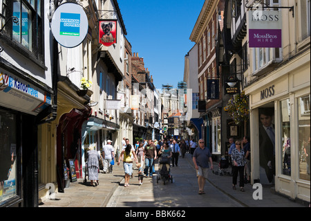 Shops on historic Stonegate in the City Centre, York, North Yorkshire, England - Stock Photo