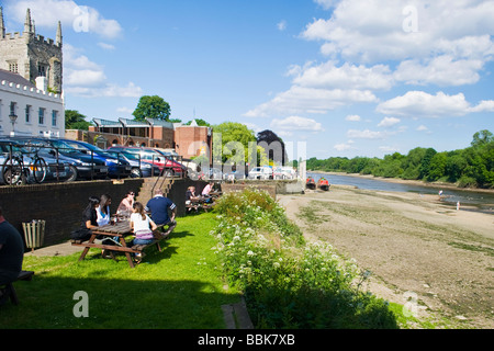 Isleworth , Hounslow , groups drinking on exterior of The London Apprentice public house lawn with River Thames - Stock Photo