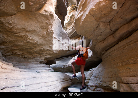 A hiker in slot canyon in Anza Borrego Desert State Park California model released - Stock Photo